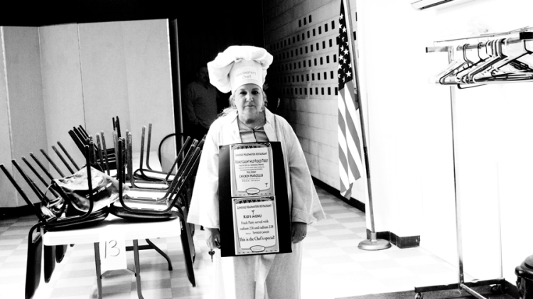 Laurie Barr, a Triple Divide Caretaker, dressed up as a chef serving a menu of Chicken Marcellus, and Eggs Benzedict in protest of the proposed fracking waste water facility at the Genesee River headwaters. © J.B.Pribanic